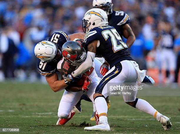 Kyle Emanuel and Craig Mager of the San Diego Chargers bottle up Freddie Martino of the Tampa Bay Buccaneers during the second half of a game at...