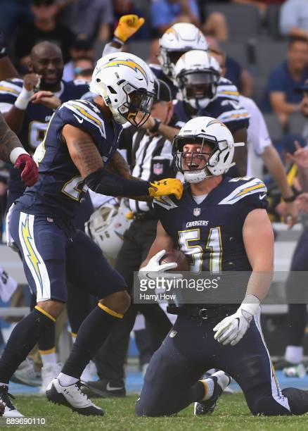 Kyle Emanuel of the Los Angeles Chargers celebrates his interception with Trevor Williams during the first quarter against the Washington Redskins at...