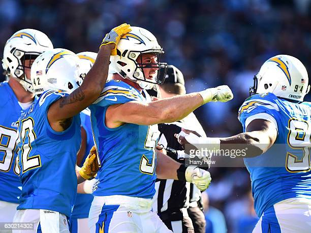 Kyle Emanuel of the San Diego Chargers celebrates his fumble recovery during the second quarter against the Oakland Raiders at Qualcomm Stadium on...