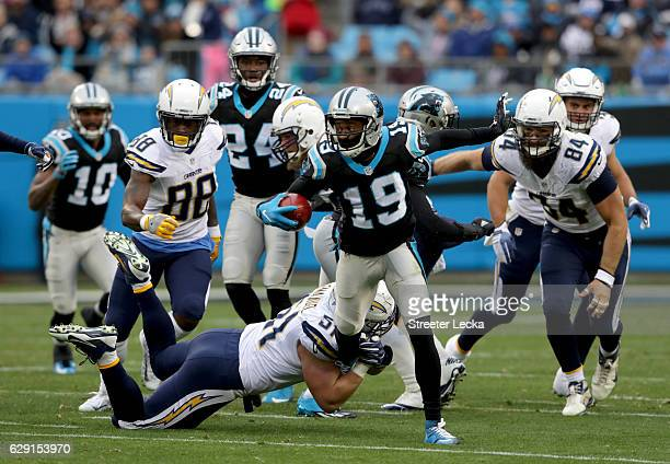 Kyle Emanuel of the San Diego Chargers tackles Ted Ginn of the Carolina Panthers during their game at Bank of America Stadium on December 11 2016 in...