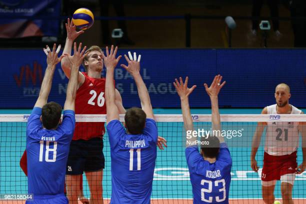 Kyle Ensing attacks Egor Kliuka Igor Philippov and Igor Kobzar during the FIVB Volleyball Nations League 2018 between USA and Russia at Palasport...