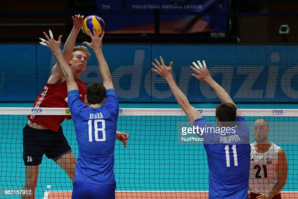 Kyle Ensing Egor Kliuka ans Igor Philippov during the FIVB Volleyball Nations League 2018 between USA and Russia at Palasport Panini on June 23 2018...