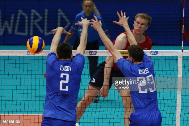 Kyle Ensing Ilia Vlasov and Igor Kobzar during the FIVB Volleyball Nations League 2018 between USA and Russia at Palasport Panini on June 23 2018 in...