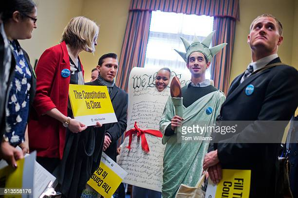 Kyle Epstein dressed as the Statue of Liberty and Corrina Qualls in the Constitution along with members of Generation Progress deliver VHS copies of...