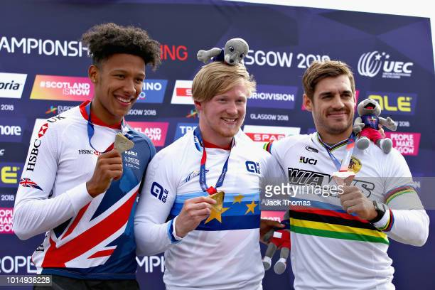 Kyle Evans of Great Britain Kye Whyte of Great Britain and Sylvain Andre of France are presented with their medals for the Men's Final during the BMX...