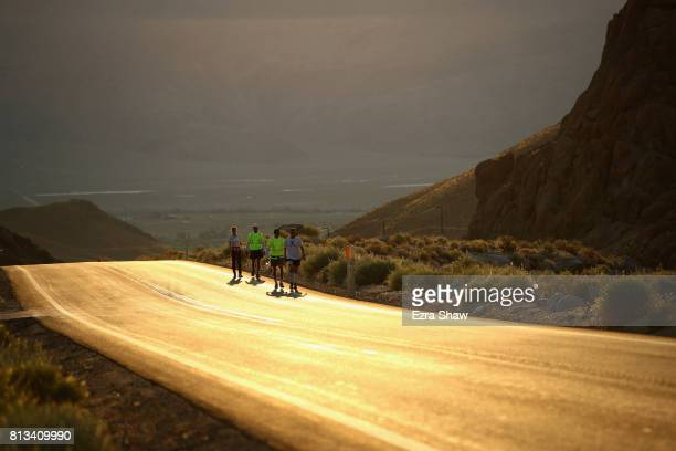 Kyle Fahrenkamp and Szilvia Lubics walk with members of their support team during the second morning of the STYR Labs Badwater 135 on July 12 2017 in...