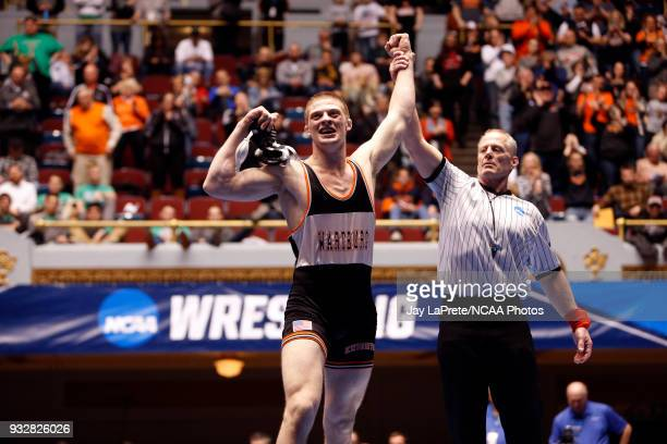 Kyle Fank of Wartburg is declared the winner after beating Guy Patron of Loras in the 197 weight class during the Division III Men's Wrestling...