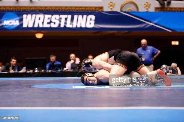 Kyle Fank of Wartburg wrestles Guy Patron of Loras in the 197 weight class during the Division III Men's Wrestling Championship held at the Cleveland...