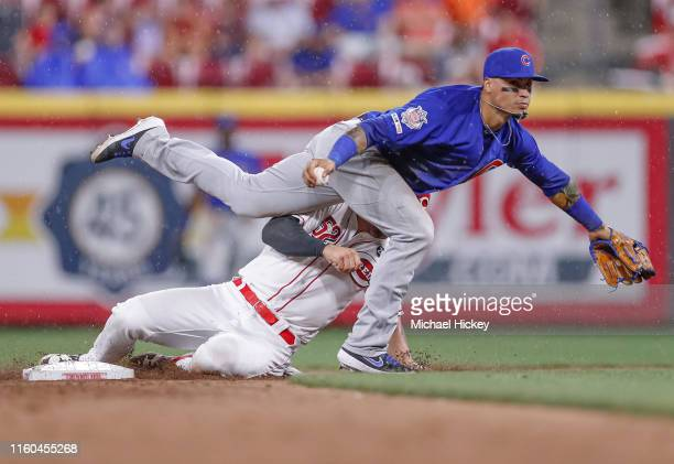 Kyle Farmer of the Cincinnati Reds breaks up the double play as Javier Baez of the Chicago Cubs doesn't get the throw off at Great American Ball Park...