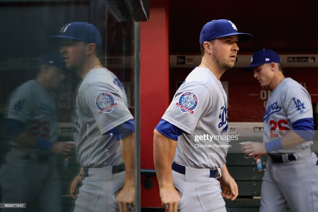 Kyle Farmer #17 of the Los Angeles Dodgers walks in the dugout before the MLB game against the Arizona Diamondbacks at Chase Field on May 1, 2018 in Phoenix, Arizona.