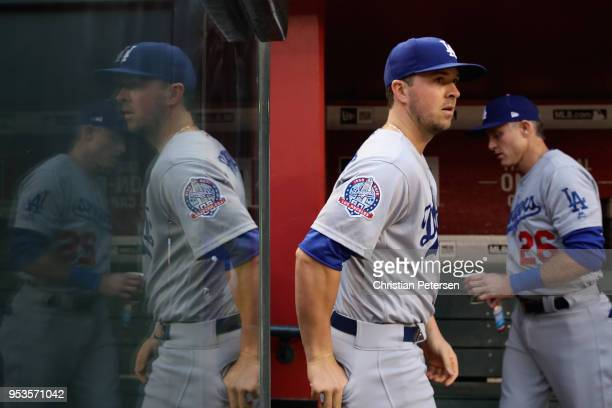 Kyle Farmer of the Los Angeles Dodgers walks in the dugout before the MLB game against the Arizona Diamondbacks at Chase Field on May 1 2018 in...