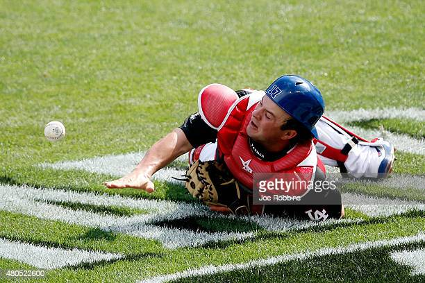 Kyle Farmer of the U.S. Team misses a foul ball against the World Team during the SiriusXM All-Star Futures Game at the Great American Ball Park on...