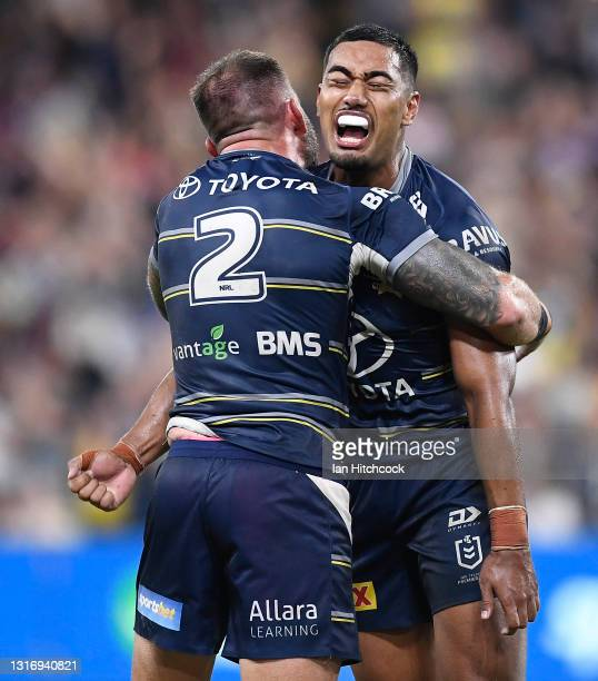Kyle Feldt and Connelly Lemuelu of the Cowboys celebrate after winning the round nine NRL match between the North Queensland Cowboys and the Brisbane...
