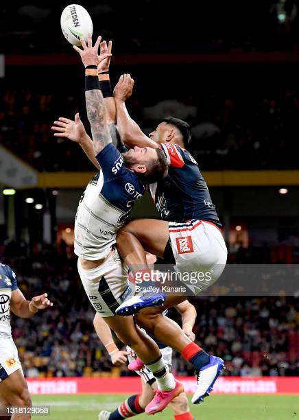 Kyle Feldt of the Cowboys and Daniel Tupou of the Roosters challenge for the ball during the round 10 NRL match between the Sydney Roosters and the...