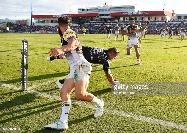 Kyle Feldt of the Cowboys catches a high ball to score a try during the round 16 NRL match between the North Queensland Cowboys and the Penrith...