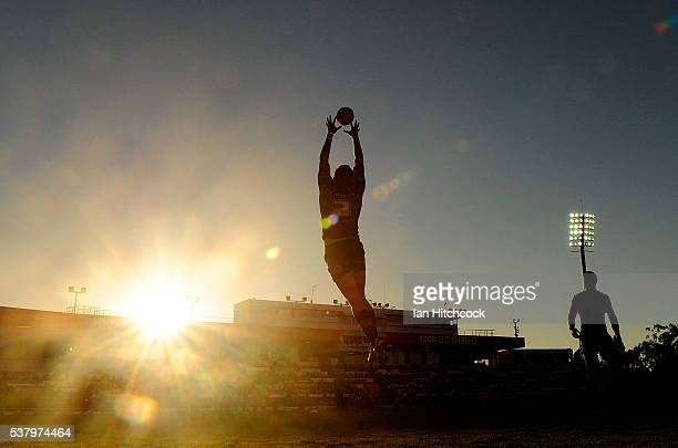 Kyle Feldt of the Cowboys catches the ball durig the warm up before the start of the round 13 NRL match between the North Queensland Cowboys and the...