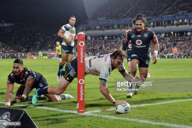Kyle Feldt of the Cowboys dives over to score a try during the round five NRL match between the New Zealand Warriors and the North Queensland Cowboys...