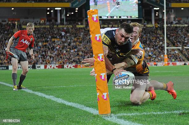 Kyle Feldt of the Cowboys drives in for a try that was later disallowed during the NRL Qualifying Final match between the Brisbane Broncos and the...