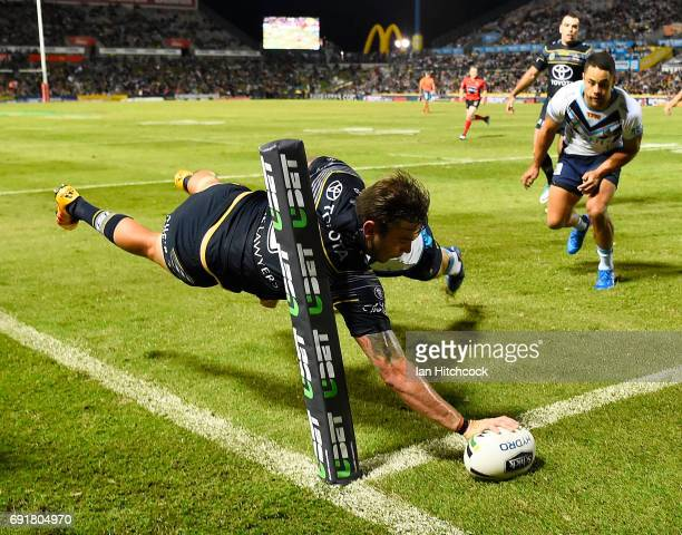 Kyle Feldt of the Cowboys scores a try during the round 13 NRL match between the North Queensland Cowboys and the Gold Coast Titans at 1300SMILES...