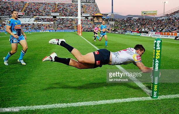 Kyle Feldt of the Cowboys scores a try during the round 23 NRL match between the North Queensland Cowboys and the Gold Coast Titans at 1300SMILES...