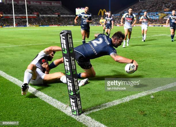 Kyle Feldt of the Cowboys scores a try during the round four NRL match between the North Queensland Cowboys and the Penrith Panthers at 1300SMILES...