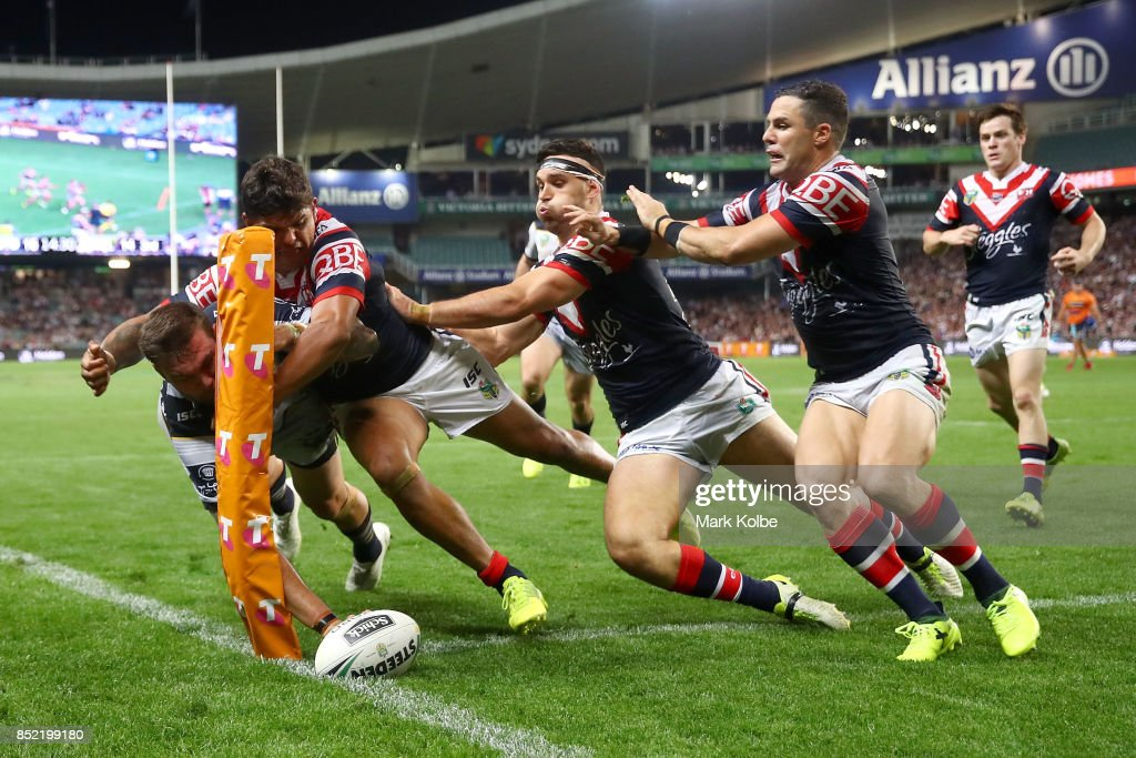 Kyle Feldt of the Cowboys scores in the corner as he is tackled during the NRL Preliminary Final match between the Sydney Roosters and the North Queensland Cowboys at Allianz Stadium on September 23, 2017 in Sydney, Australia.