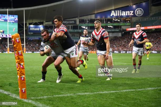 Kyle Feldt of the Cowboys scores in the corner as he is tackled during the NRL Preliminary Final match between the Sydney Roosters and the North...