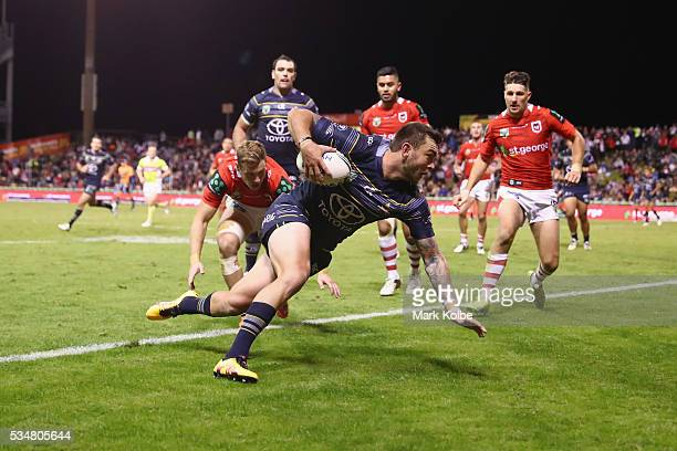 Kyle Feldt of the Cowboys scores try during the round 12 NRL match between the St George Illawarra Dragons and the North Queensland Cowboys at WIN...