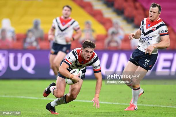 Kyle Flanagan of the Roosters scores a try during the round four NRL match between the Brisbane Broncos and the Sydney Roosters at Suncorp Stadium on...
