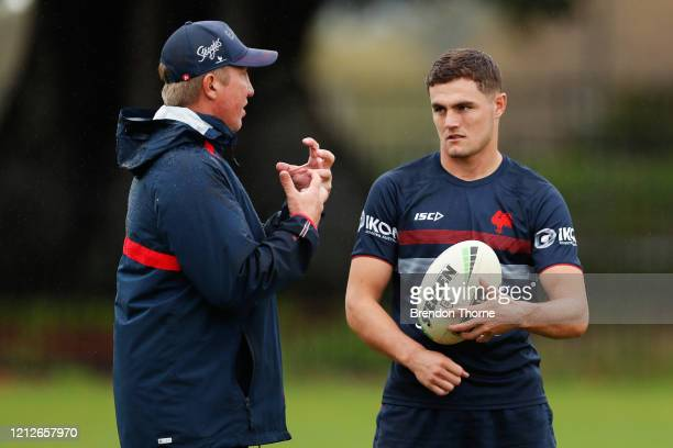 Kyle Flanagan of the Roosters speaks with Roosters coach, Trent Robinson during a Sydney Roosters NRL training session at Kippax Lake on March 16,...