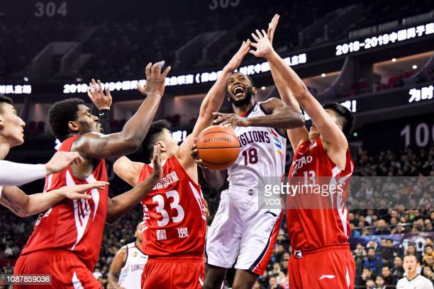 Kyle Fogg of Guangzhou LongLions handles the ball against Qingdao Eagles players during the 2018/2019 Chinese Basketball Association League 26th...