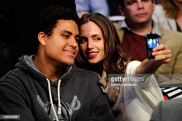 Kyle Fox the son of former NBA player Rick Fox poses with actress Eliza Dushku as they attend NBA AllStar Saturday night presented by State Farm at...