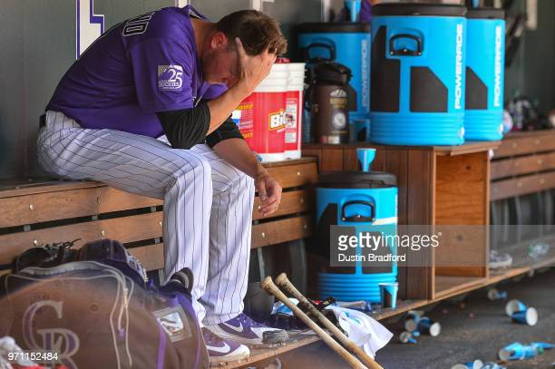 Kyle Freeland of the Colorado Rockies hangs his head in the dugout after allowing three runs to the Arizona Diamondbacks in the sixth inning of a...