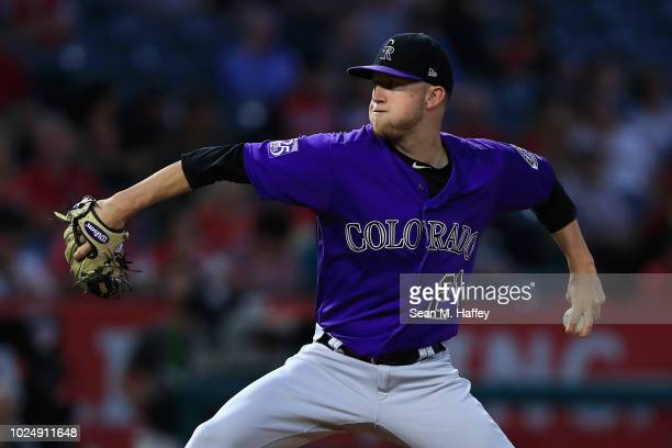 Kyle Freeland of the Colorado Rockies pitches during the first inning of a game against the Los Angeles Angels of Anaheim at Angel Stadium on August...
