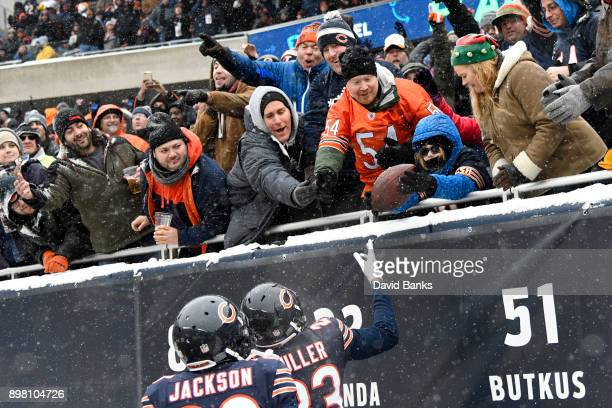 Kyle Fuller of the Chicago Bears gives a fan the football after making an interception against the Cleveland Browns in the second quarter at Soldier...