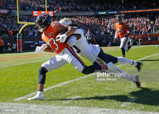 Kyle Fuller of the Chicago Bears is tackled by Melvin Gordon of the Los Angeles Chargers following his interception during the first half at Soldier...