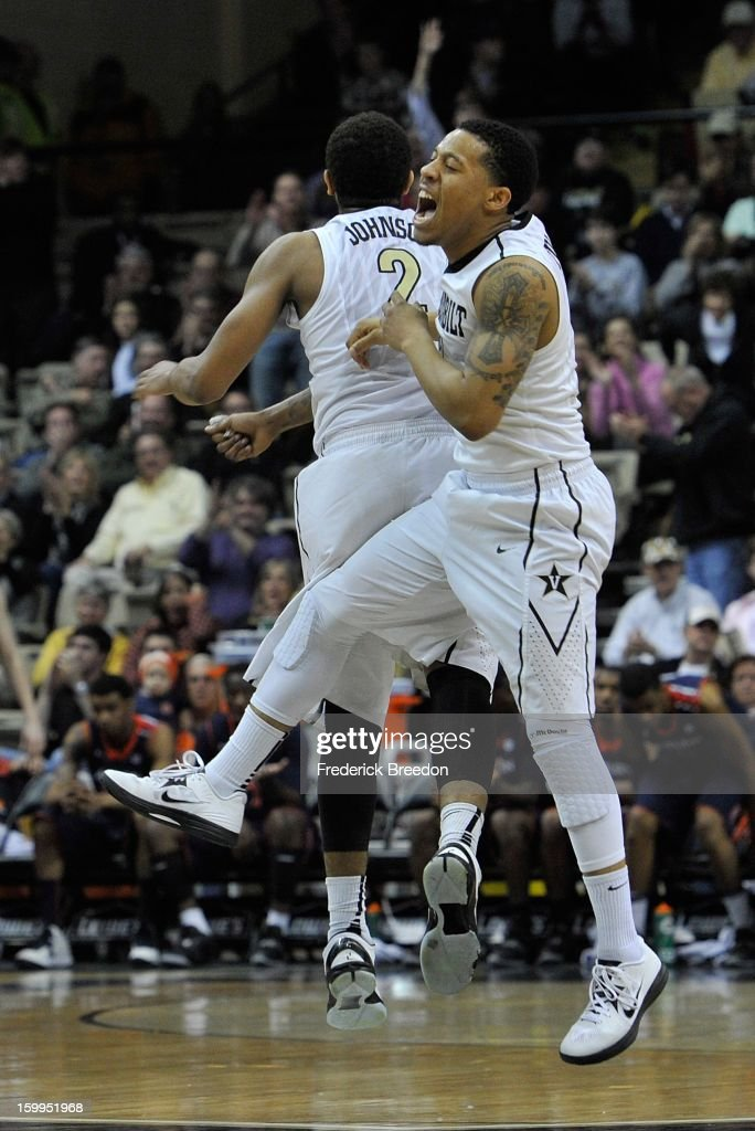 Kyle Fuller #11 of the Vanderbilt Commodores celebrates a basket against the Auburn Tigers with teammate Kedren Johnson #2 at Memorial Gym on January 23, 2013 in Nashville, Tennessee.