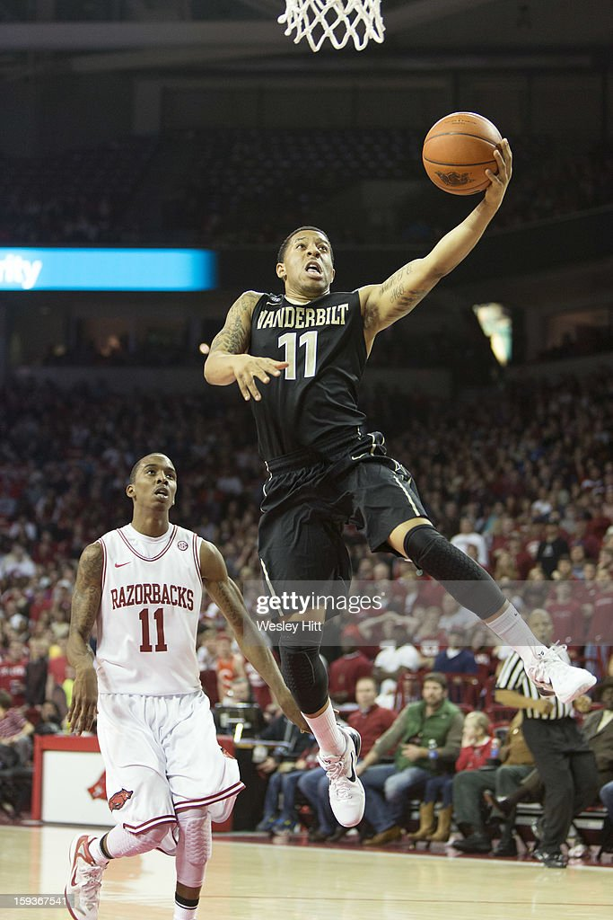 Kyle Fuller #11 of the Vanderbilt Commodores goes up for a layup against the Arkansas Razorbacks at Bud Walton Arena on January12, 2013 in Fayetteville, Arkansas. The Razorbacks defeated the Commodores 56-33.
