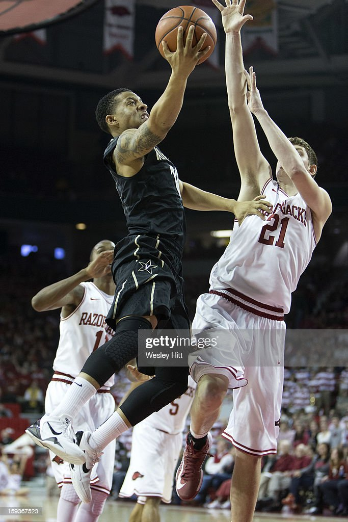 Kyle Fuller #11 of the Vanderbilt Commodores goes up for a layup past Hunter Mickelson #21 of the Arkansas Razorbacks at Bud Walton Arena on January12, 2013 in Fayetteville, Arkansas. The Razorbacks defeated the Commodores 56-33.