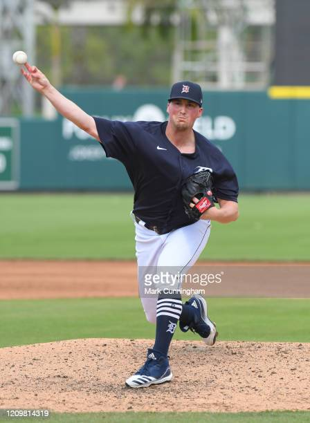 Kyle Funkhouser of the Detroit Tigers throws a warm-up pitch during the Spring Training game against the New York Mets at Publix Field at Joker...