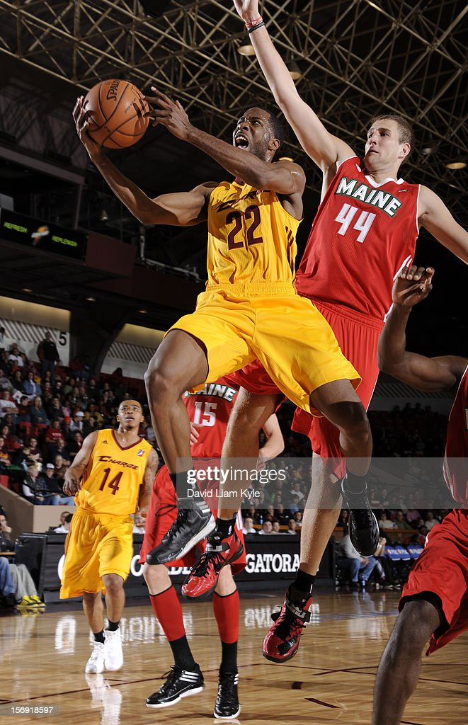 Kyle Gibson #22 of the Canton Charge goes up for the shot against Scott VanderMeer #44 of the Maine Red Claws at the Canton Memorial Civic Center on November 23, 2012 in Canton, Ohio.