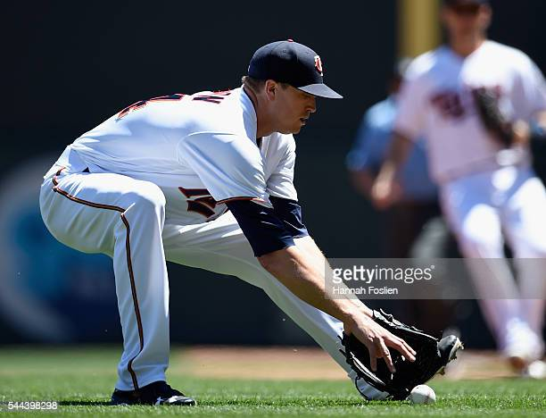 Kyle Gibson of the Minnesota Twins fields the ball hit by Rougned Odor of the Texas Rangers before throwing out Odor at first base during the second...