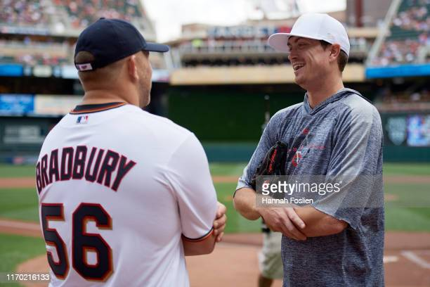Kyle Gibson of the Minnesota Twins speaks with Garrett Bradbury of the Minnesota Vikings before the game against the Detroit Tigers on August 25 2019...
