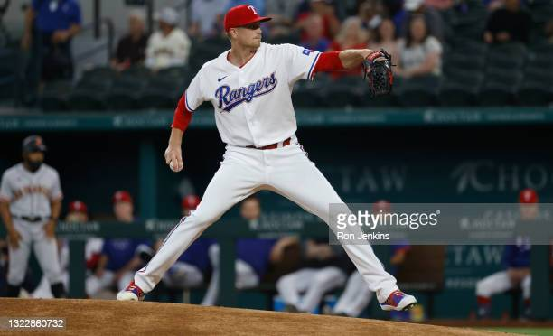 Kyle Gibson of the Texas Rangers delivers against the San Francisco Giants during the first inning at Globe Life Field on June 9, 2021 in Arlington,...