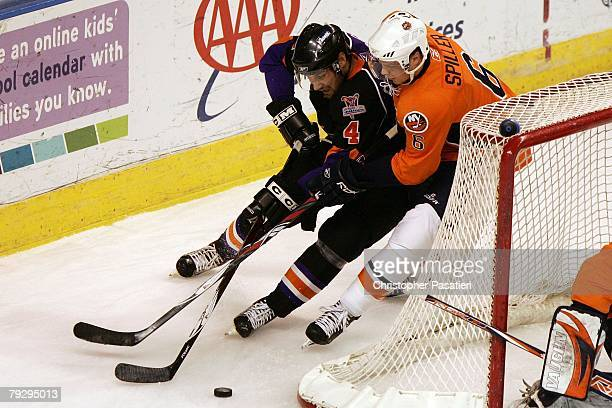 Kyle Greentree of the Philadelphia Phantoms plays for possession of the puck against Matthew Spiller of the Bridgeport Sound Tigers during the first...