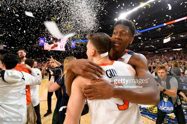 Kyle Guy and De'Andre Hunter of the Virginia Cavaliers celebrate their victory over the Texas Tech Red Raiders during the 2019 NCAA Photos via Getty...