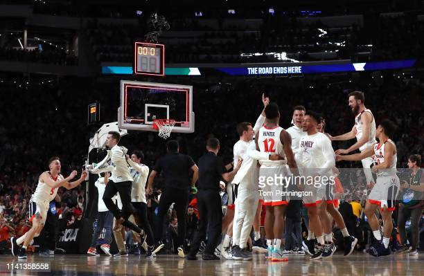 Kyle Guy and The Virginia Cavaliers celebrate their teams 8577 win over the Texas Tech Red Raiders to win the the 2019 NCAA men's Final Four National...