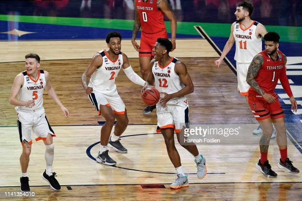 Kyle Guy De'Andre Hunter and Braxton Key of the Virginia Cavaliers celebrate their teams 8577 win over the Texas Tech Red Raiders during the 2019...