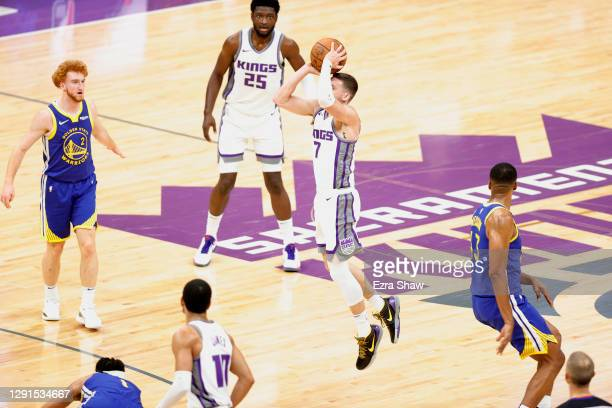 Kyle Guy of the Sacramento Kings makes a game-winning three point basket at the buzzer to beat the Golden State Warriors at Golden 1 Center on...