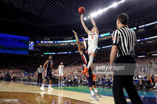 Kyle Guy of the Virginia Cavaliers attempts a gamewinning three point basket as he is fouled by Samir Doughty of the Auburn Tigers in the second half...